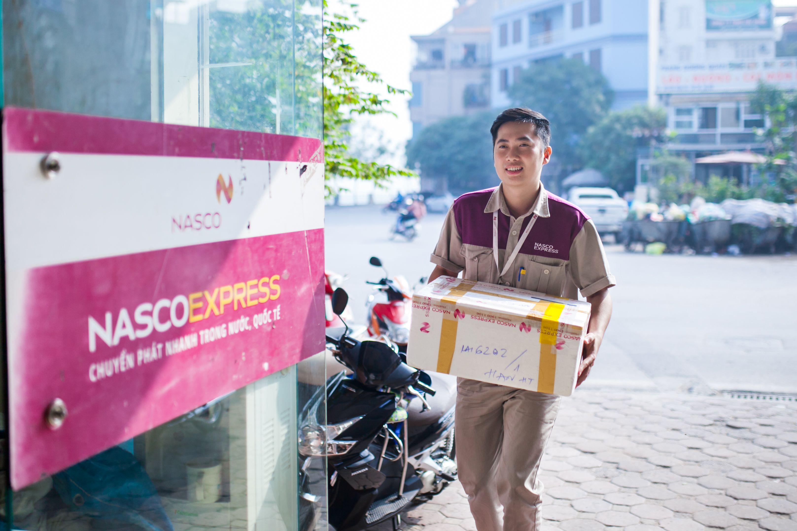 Áo bảo hộ đồng phục nhân viên Dịch Vụ Chuyển Phát Nhanh Nasco ở Hà Nội 20